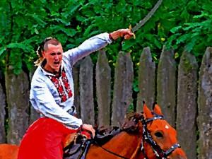 казачий атаман в атаке на коне